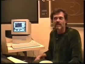Terence McKenna with his Timewave on the computer