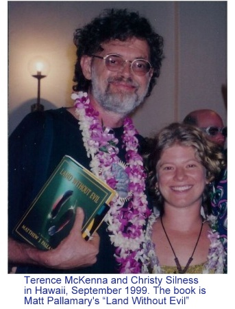 "Terence McKenna & Cristy Silness with a copy of ""Land Without Evil"" by Matthew Pallamary"
